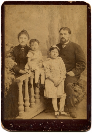 RUSSIA - CIRCA  the end of XIX - early XX century  An antique photo shows married couple with two daughters, Lugansk, Russian Empire, now UkraineRussian text  Umanskiy  photographer , Lugansk