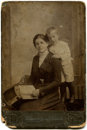 RUSSIA - CIRCA  the end of XIX - early XX century  An antique photo shows Mother and son, Lugansk, Russian Empire, now UkraineRussian text  Umanskiy  photographer , Lugansk