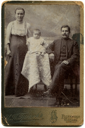 xx century: RUSSIA - CIRCA  the end of 19 - early 20century  An antique photo shows couple with daughter, Essentuki, the Caucasus, the Russian EmpireRussian text  Grekov  photographer , Essentuki Editorial