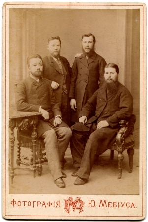 clergy: RUSSIA - CIRCA  the end of 19 - early 20century  An antique photo shows Four of the clergy in secular clothes, Moscow, Russian EmpireRussian text  Mebius Editorial