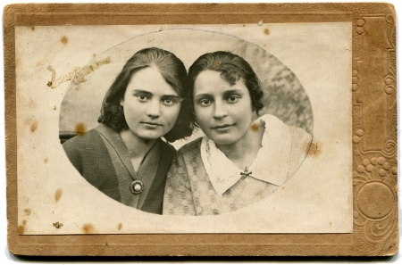 xx century: USSR - CIRCA 1933  An antique photo shows two sisters, USSR, 1933 Editorial
