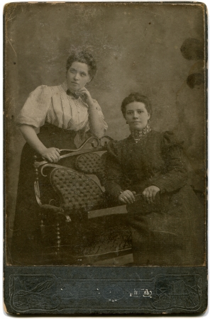 xx century: RUSSIA - CIRCA  the end of XIX - early XX century  An antique photo shows Two women, Lugansk, Russian Empire, now UkraineRussian text  Umanskiy  photographer , Lugansk Editorial