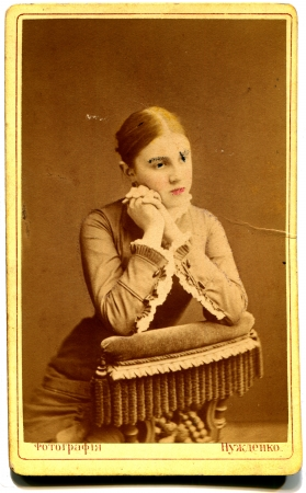 black and white photograph: RUSSIA - CIRCA  1981  An antique photo shows young woman, Kursk, the Russian Empire, 1881Russian text  Nuzdenko  photographer , Kursk
