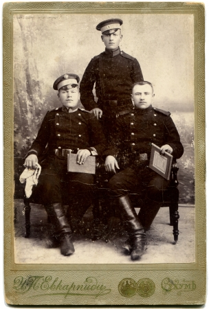 sukhumi: RUSSIA - CIRCA  1914 - 1917  An antique photo shows three soldiers, Sukhumi, Russian Empire, during the First World WarRussian text  Evkarpidi  photographer , Sukhum