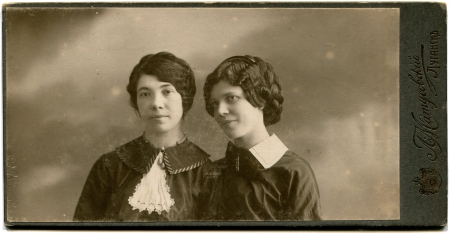lugansk: RUSSIA - CIRCA  the end of 19 - early 20 century  An antique photo shows two young women, Lugansk, Russian Empire, UkraineRussian text  Umanskiy  photographer , Lugansk