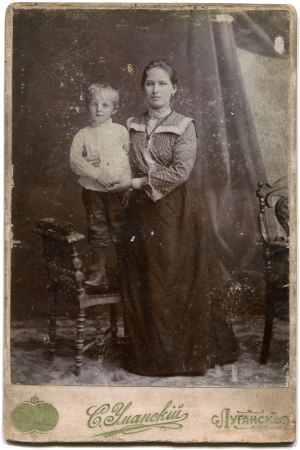 lugansk: RUSSIA - CIRCA  the end of 19 - early 20 century  An antique photo shows woman with a boy on a chair, Lugansk, Russian EmpireRussian text  Umanskiy  photographer , Lugansk Editorial