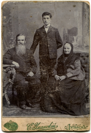 lugansk: RUSSIA - CIRCA  the end of 19 - early 20 century  An antique photo shows elderly parents and adult son, Lugansk, Russian Empire, now Ukraine  Russian text  Umanskiy  photographer , Lugansk