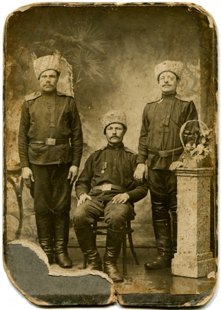 RUSSIA - CIRCA  1914 - 1917  An antique photo shows three soldiers in fur hats, Russian Empire, period of the First World War
