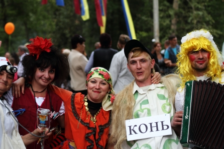 cossack parade: STANITSA LUGANSKAYA, UKRAINE - SEPTEMBER, 8, 2012  mummers - traditional participants folk festivities, International Cossack festival, Stanitsa Luganskaya, Ukraine, September 8, 2012 Editorial