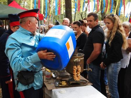 cossack: STANITSA LUGANSKAYA, UKRAINE - SEPTEMBER, 8, 2012  cossacks prepearing tea, International Cossack festival, Stanitsa Luganskaya, Ukraine, September 8, 2012