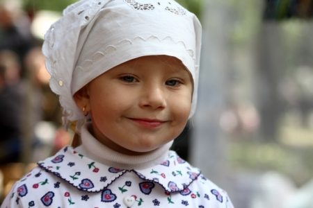 pious: STANITSA LUGANSKAYA, UKRAINE - SEPTEMBER, 8, 2012 daughter of Don Cossack Nastya,  International Cossack festival, Stanitsa Luganskaya, Ukraine, September 8, 2012