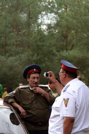 cossack: STANITSA LUGANSKAYA, UKRAINE - SEPTEMBER, 8, 2012  fat man take photo of Don Cossack, International Cossack festival, Stanitsa Luganskaya, Ukraine, September 8, 2012 Editorial