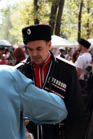 cossack: STANITSA LUGANSKAYA, UKRAINE - SEPTEMBER, 8, 2012  Kuban Cossack in clothing of the late 19th century, International Cossack festival, Stanitsa Luganskaya, Ukraine, September 8, 2012