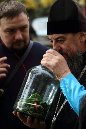LUGANSK - OCT 14  Don Cossack  tells Orthodox priest about ancient cooking utensil vodka infusions, celebration of the Protection of the Mother of God, Lugansk, Ukraine, October 14, 2012  Stock Photo - 16283982