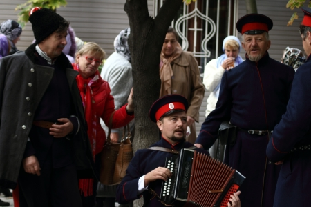 luhansk:  LUGANSK - OCT 14  Don Cossack singing old songs with garmon, celebration of the Protection of the Mother of God, Lugansk, Ukraine, October 14, 2012