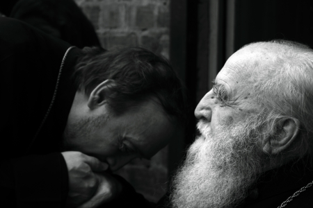 lugansk: LUGANSK - NOV 4  priest kisses had of his mentor, religious procession, Lugansk, Ukraine, November 4, 2012 Editorial