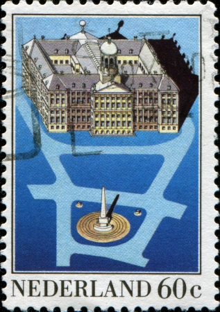 dam square:  NETHERLANDS - CIRCA 1982  A stamp printed in Netherlands shows Royal Palace, Dam Square, Amsterdam  Aerial view of Palace and Liberation Monument, circa 1982