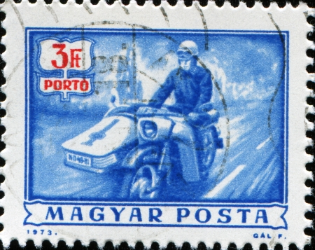 HUNGARY - CIRCA 1973  A stamp printed in Hungary shows postman on motorbike, circa 1973