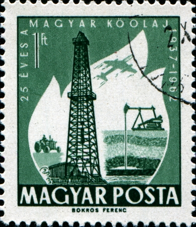 HUNGARY - CIRCA 1962  A stamp printed in  Hungary shows Primitive and Modern Oilwells, circa 1962