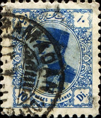 mohammad: IRAN - CIRCA 1933  A stamp printed in the Iran shows Mohammad Reza Pahlavi of Iran, circa 1933