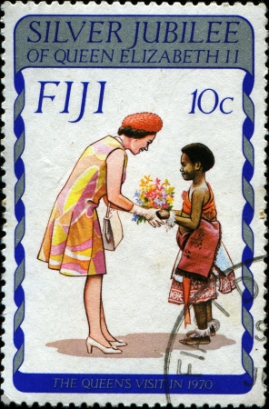 FIJI - CIRCA 1977  A stamp printed in Fiji honoring Silver Jubillee shows Queen Elizabeth II shows the Queen visit in 1970, circa 1977