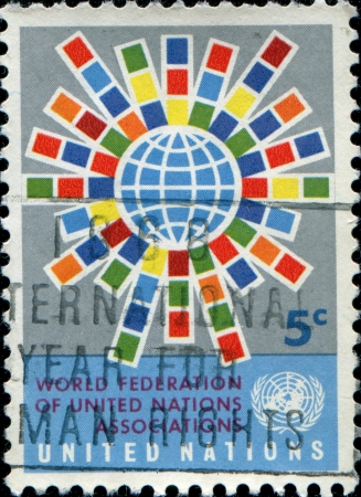 un used:  UNITED NATIONS, OFFICES IN NEW YORK - CIRCA 1966  A stamp printed UN shows World Federation of United Nations Associations emblem, circa 1966  Editorial