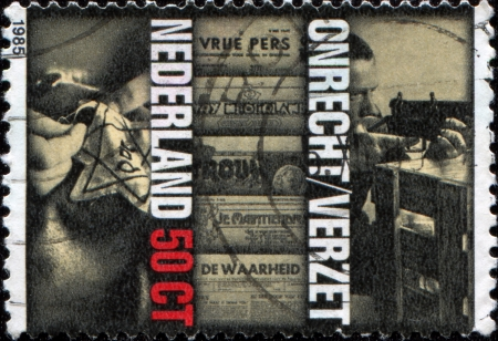 world war ii: NETHERLANDS - CIRCA 1985  A stamp printed in  Netherlands shows Star of David, Illegal Newspapers and Rifle Practice  Resistance Movement ,  40th Anniversary of Liberation, circa 1985