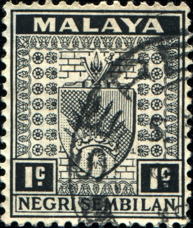 malaya: MALAYA - CIRCA 1935  A stamp printed in state Negri Sembilan shows coat of arms Negri Sembilan, circa 1935