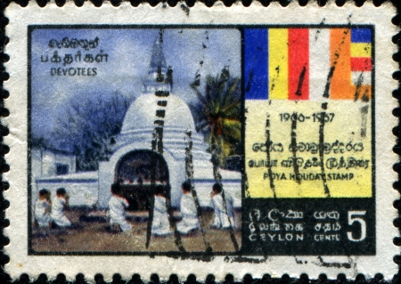 ceylon: CEYLON - CIRCA 1967  A stamp printed in the Ceylon honoring Poya Holiday System, shows Devotees at Buddhist Temple, circa 1967