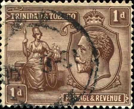 TRINIDAD AND TOBAGO - CIRCA 1922  A stamp printed in Trinidad and Tobago shows female figure - symbol of Britain, circa 1922 Stock Photo - 17269771
