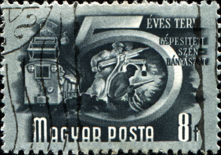 HUNGARY - CIRCA 1950  A stamp printed in Hungary shows image celebrating the five year plan for the mechanisation of the coal mining industry, series, circa 1950