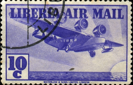 LIBERIA - CIRCA 1938: A stamp printed in Liberia shows Flying Boat, circa 1938 Stock Photo - 17261745