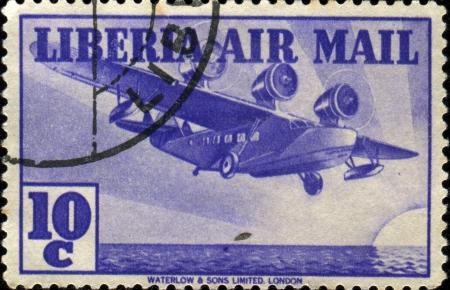 LIBERIA - CIRCA 1938: A stamp printed in Liberia shows Flying Boat, circa 1938 Stock Photo - 17261745