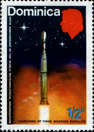 meteorological: DOMINICA - CIRCA 1973: A stamp printed in Dominica issued for the centenary of the World Meteorological Organization shows the launching of weather satellite, circa 1973 Editorial