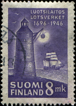 FINLAND - CIRCA 1946: A stamp printed in Finland shows Lighthouse and sailboat, circa 1946  Stock Photo - 17262138
