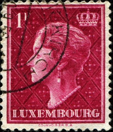 reign:  LUXEMBOURG - CIRCA 1948: A stamp printed in  Luxembourg shows Charlotte, Grand Duchess of Luxembourg, Reign from 1919 to 1964, circa 1948  Editorial