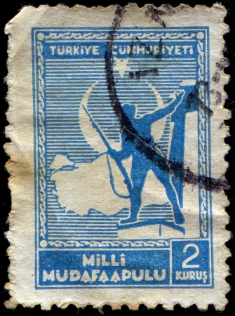 TURKEY- CIRCA 1941  A stamp printed in Turkey shows Soldier and Map of Turkey, circa 1941