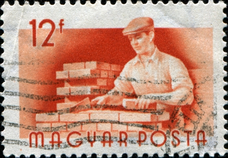 HUNGARY - CIRCA 1956  A stamp printed in  Hungary shows  Bricklayer , circa 1956 Stock Photo - 17262164