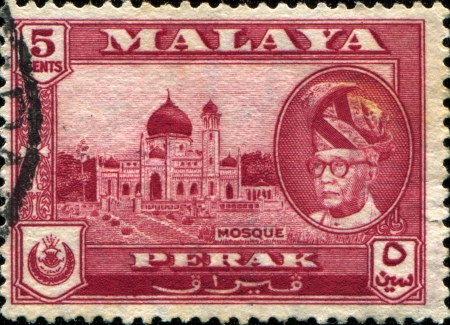 MALAYA - CIRCA 1957: A stamp printed in Malaya showsMasjid Alwi Mosque, Kangar and portrait of Sultan Yussuf Izzuddin Shah of Perak, circa 1957