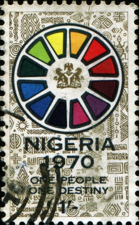 motto:  NIGERIA - CIRCA 1970: A stamp printed in Nigeria honoring End of Civil War, shows Symbolic wheel and motto one people, one destiny, circa 1970  Editorial