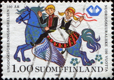 FINLAND - CIRCA 1981: A stamp printed in  Finland shows Boy and Girl Riding Pegasus, Centenary of Youth Associations, circa 1981  Stock Photo - 17262160