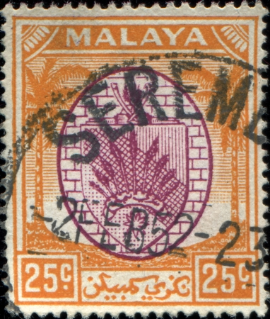 malaya:  MALAYA - CIRCA 1952: A stamp printed in state Malaya shows coat of arms of Malaya, circa 1952