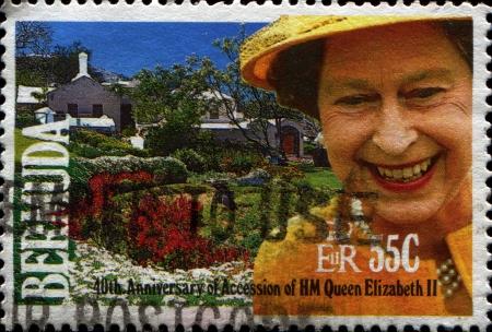 BERMUDA - CIRCA 1997  A stamp printed in Bermuda shows Queen Elizabeth II and Cottage garden, circa 1997