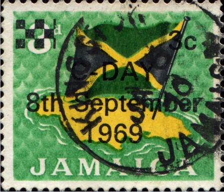 JAMAICA - CIRCA 1969  A stamp printed in Jamaica showing map and flag of Jamaica, circa 1969 Stock Photo - 17269451
