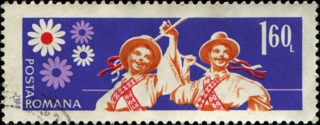 ROMANIA - CIRCA 1968: A stamp printed in  Romania shows Young Pioneers, Folk-dancing , circa 1968
