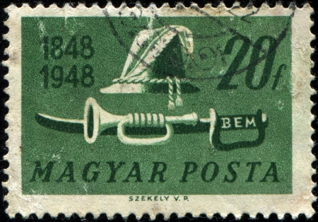 insurrection: HUNGARY - CIRCA 1948: A stamp printed by Hungary honoring Centenary of Insurrection, shows Shako, trumpet and sword , circa 1948  Editorial