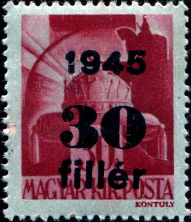 CIRCA 1943: stamp printed in Hungary, shows a Holy Crown of Hungary (St. Stephen Crown) Stock Photo - 17262165