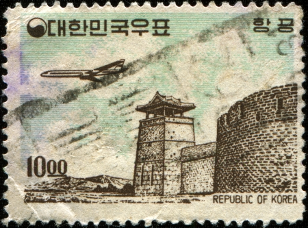 west gate: KOREA - CIRCA 1961  A stamp printed in South Korea shows  Plane over West Gate, Suwon , circa 1961