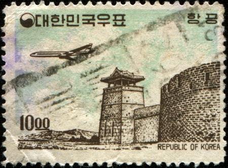 KOREA - CIRCA 1961  A stamp printed in South Korea shows  Plane over West Gate, Suwon , circa 1961 Stock Photo - 17269445