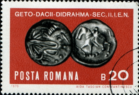 ROMANIA - CIRCA 1970: A stamp printed in Romania shows Emperor Trajans copper sestertius, circa 1970  Stock Photo - 17262101